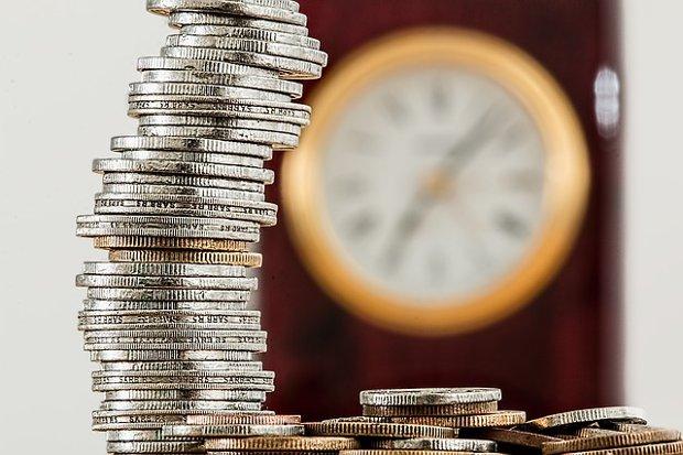Geld Zeit Arbeit Münzen Stock